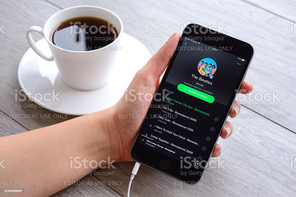 Spotify on iPhone stock photo