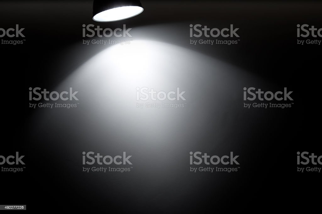 Spotlight on a black background stock photo