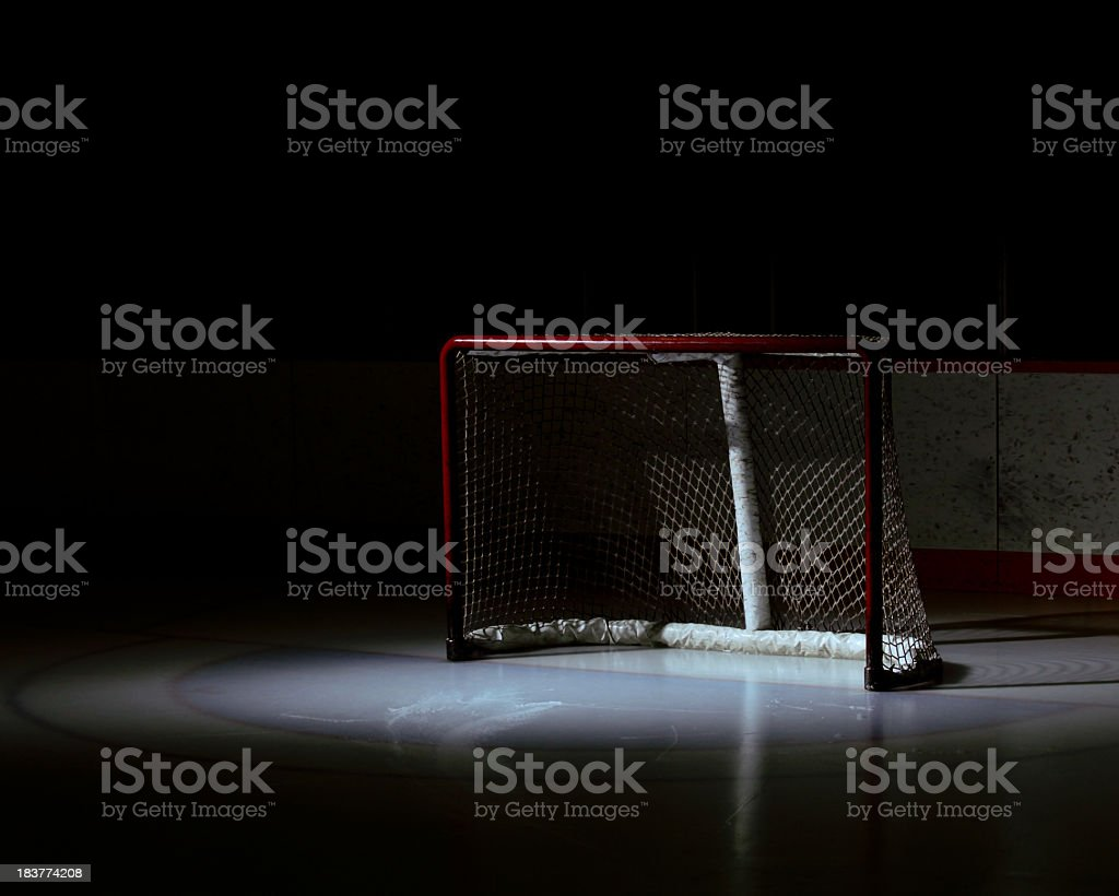Spotlight on an empty hockey net royalty-free stock photo