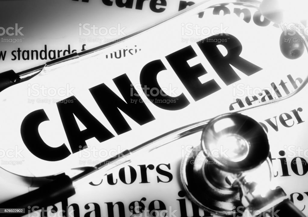 Spotlight on newpaper headlines all about cancer stock photo