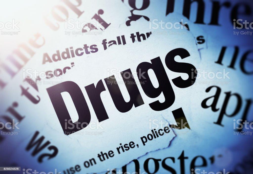 Spotlight on newpaper headlines all about drugs stock photo
