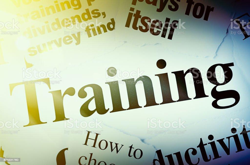 Spotlight on newpaper headlines all about training stock photo