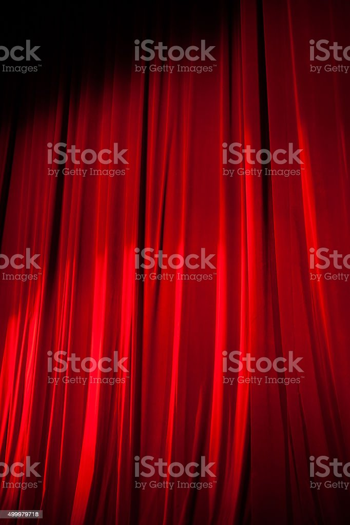Spotlight Shining on the Red Stage Curtain stock photo