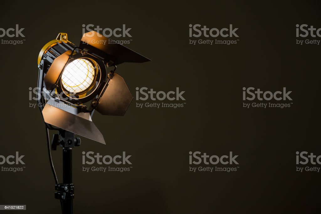 Spotlight with directional light with a Fresnel lens, halogen lamp and protective shutters. stock photo