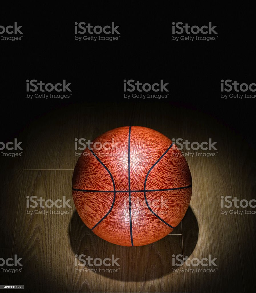 Spotlighted Basketball lonely on a Gym Floor stock photo