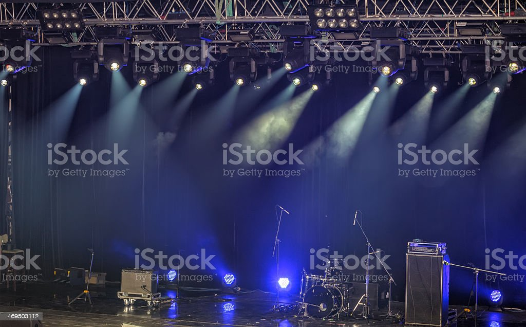 Spotlights and illumination on stage with sound equipment stock photo