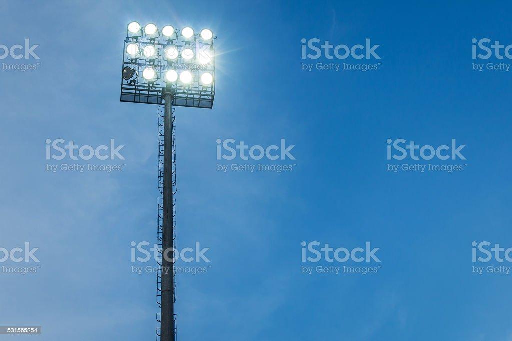 Spotlights in stadium blue sky evening stock photo