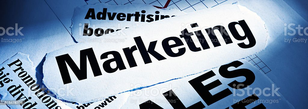 Spotlit headlines on Marketing, Promotions, and Advertising stock photo