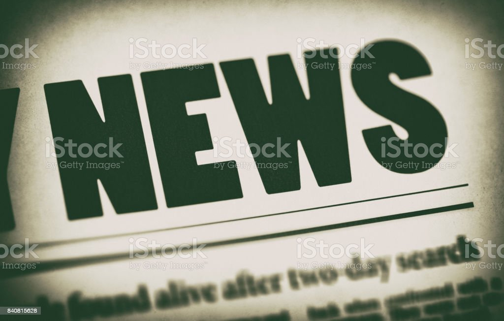 Spotlit newspaper title and part of headline news stock photo