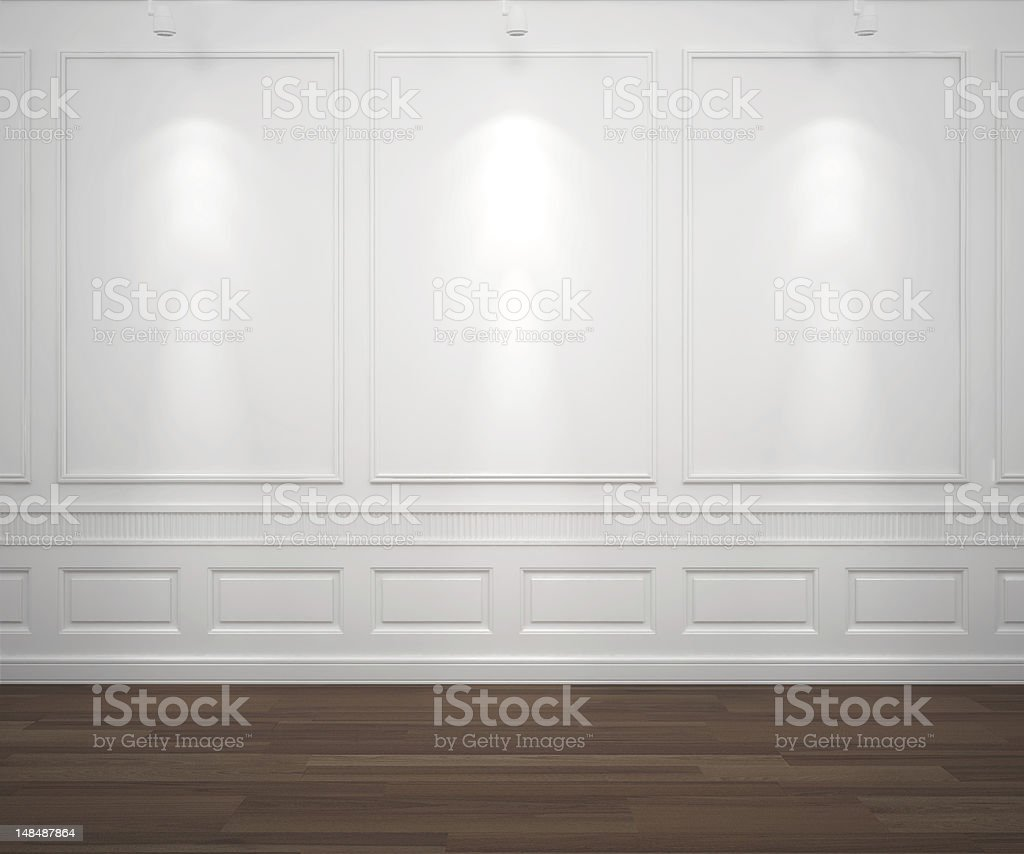 spotslight on white classis wall stock photo