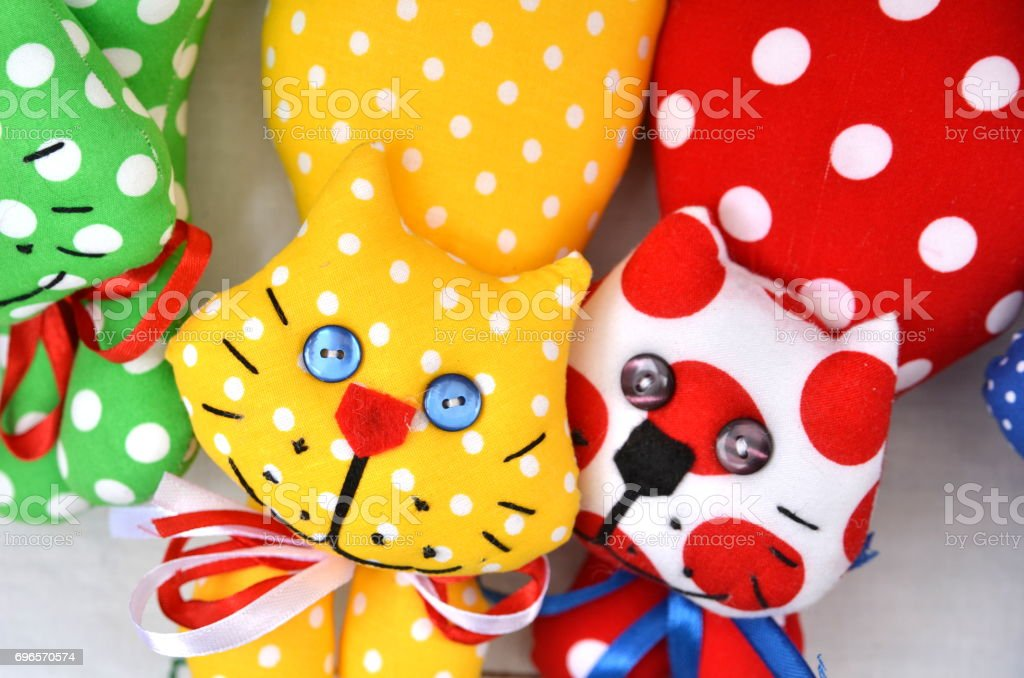 Spotted toy cats stock photo