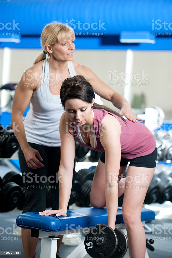 Spotting a Woman Lifting Weights stock photo