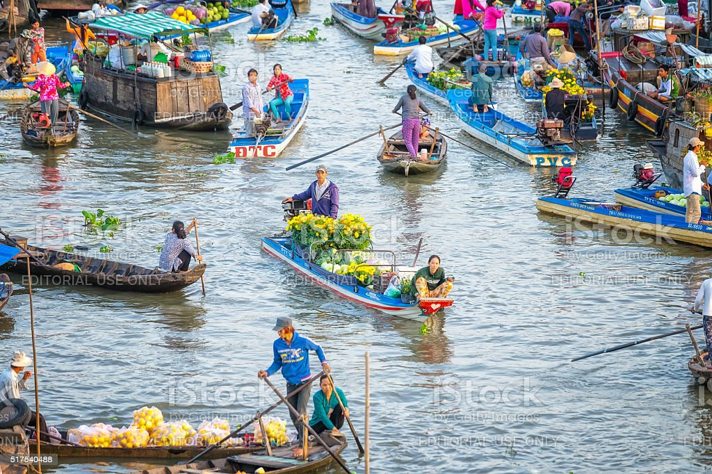 Spouses boatman selling daisies, watermelons on the river stock photo