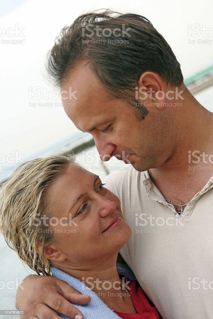 Spouses on a beach royalty-free stock photo