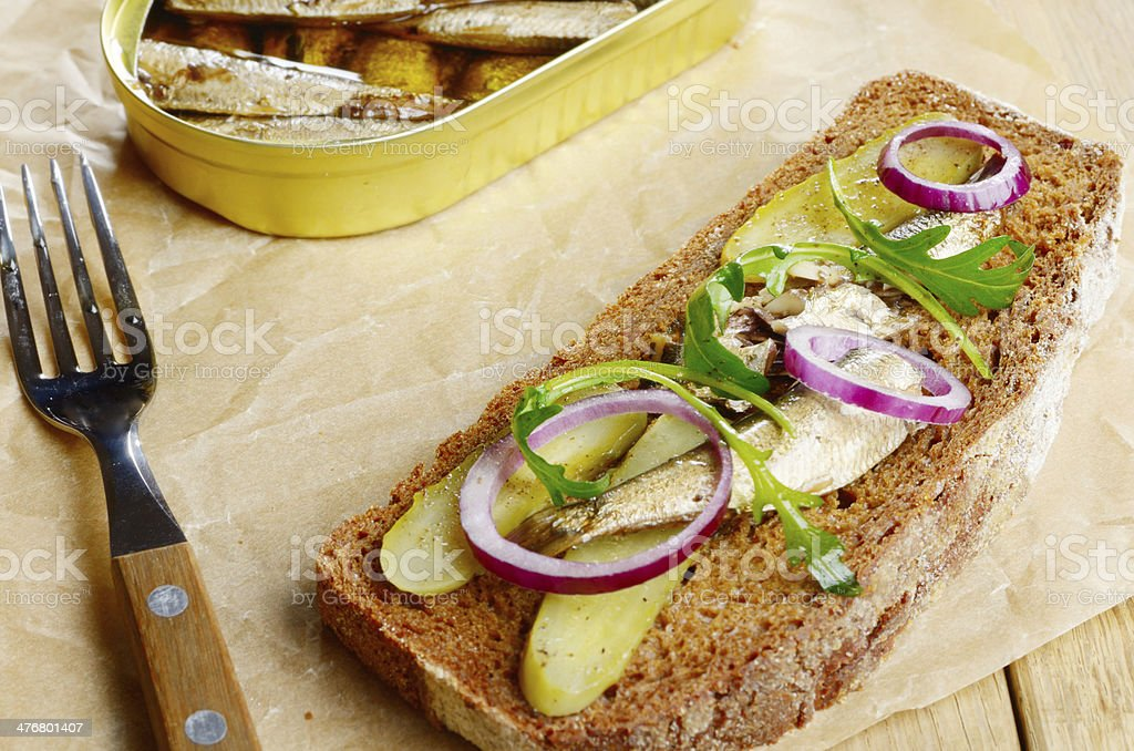 Sprat sandwich with pickled vegetables royalty-free stock photo