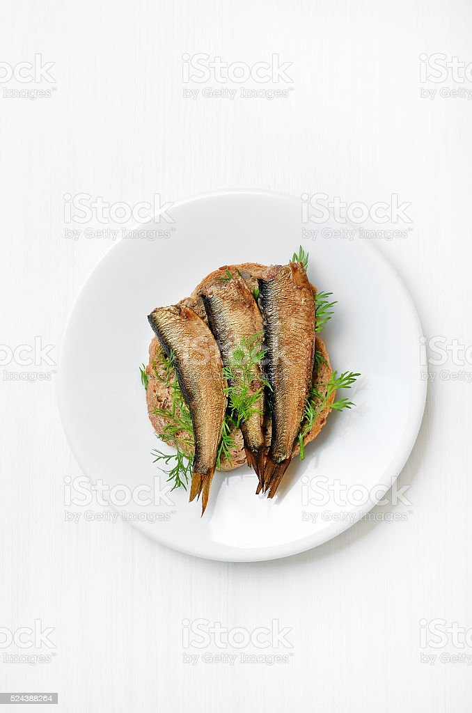 Sprats sandwiches on white plate stock photo
