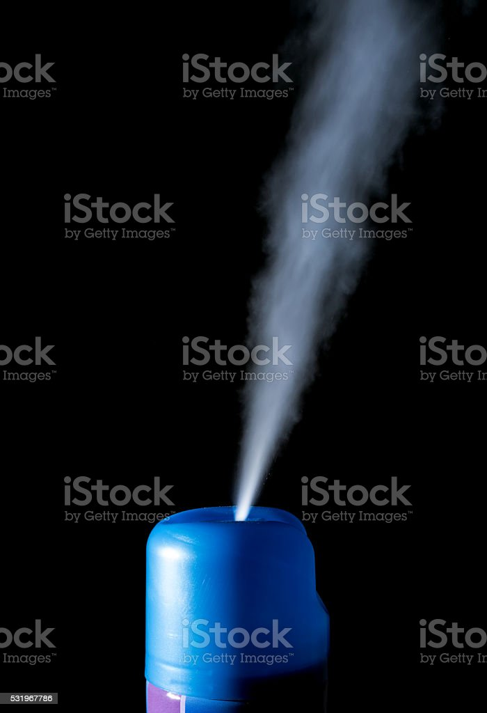 Spray air freshener isolated on a black stock photo