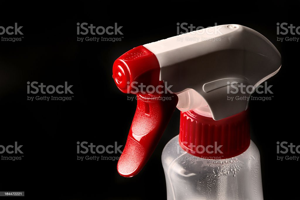 Spray bottle studio shot on black background royalty-free stock photo