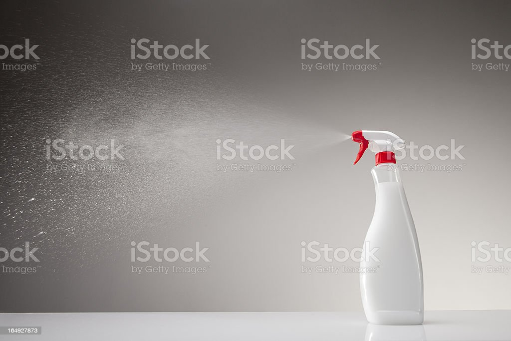 Spray bottle studio shot on gray gradient background stock photo
