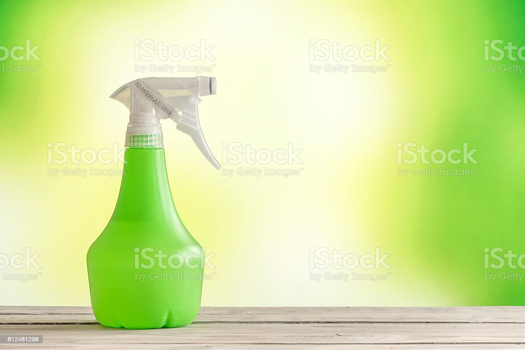 Spray can on a wooden table stock photo