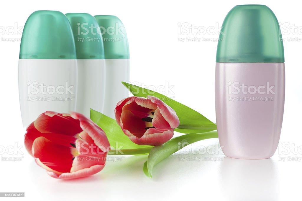 Spray deodorant bottles with tulips stock photo