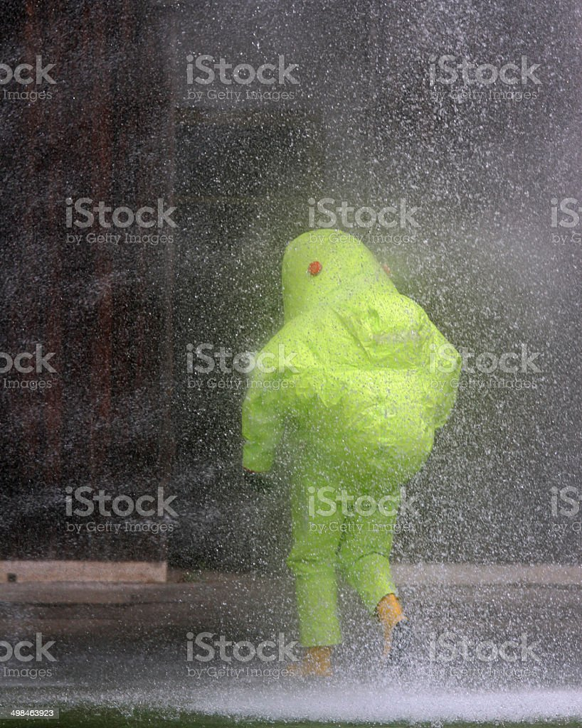 spray of water toward the person with the suit stock photo
