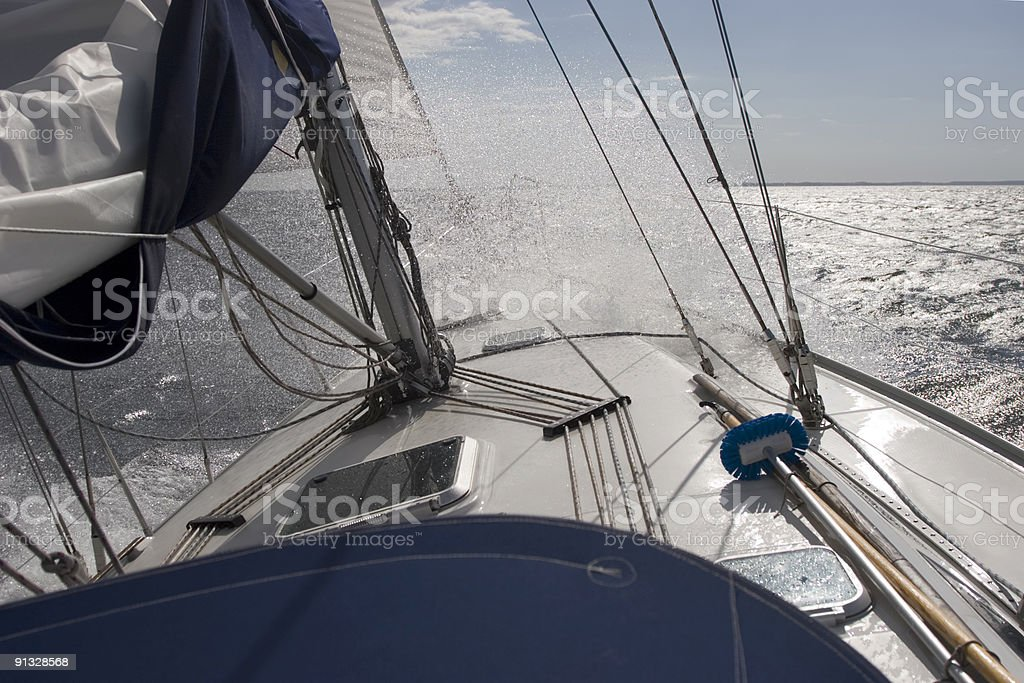 Spray over the bow of a sailing boat royalty-free stock photo