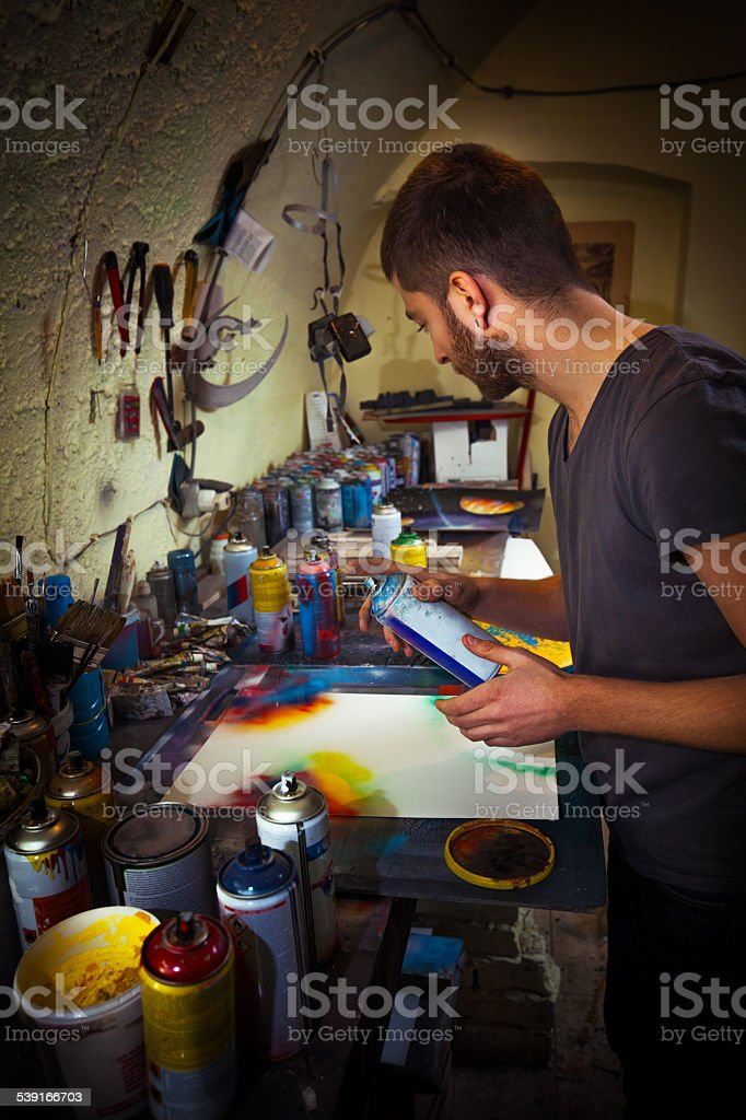 Spray Paint Artist at Work stock photo