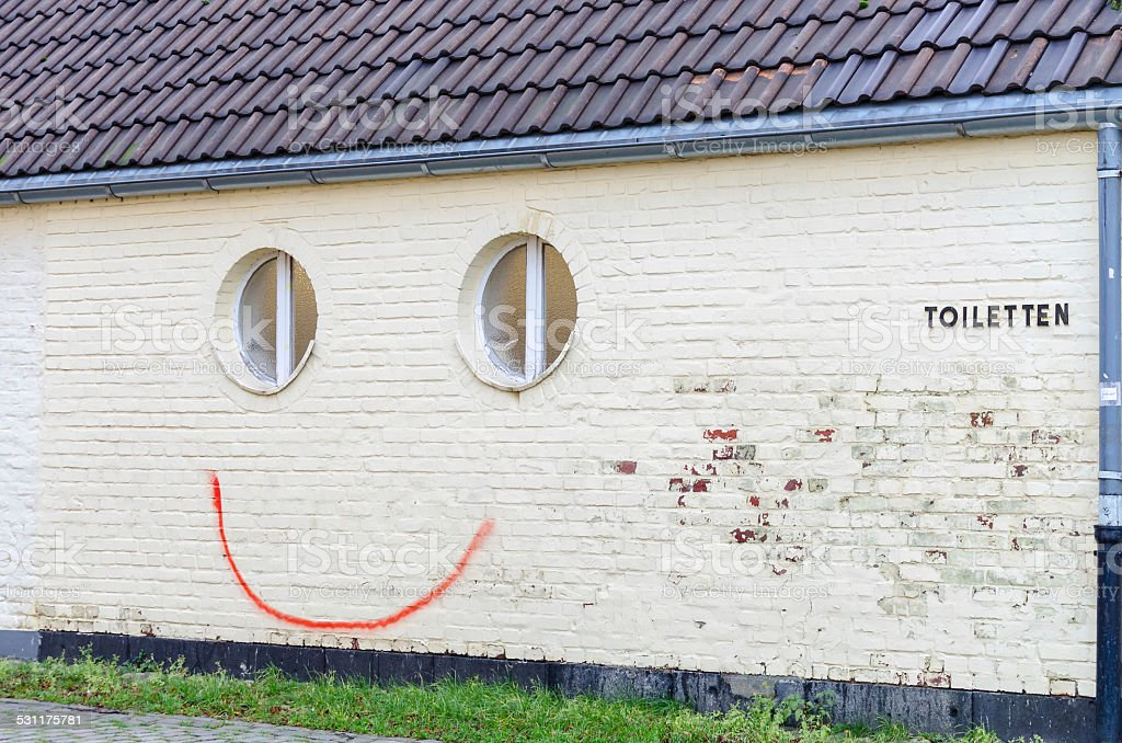 Spray painted smiley stock photo