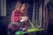 Spray painting a skateboard
