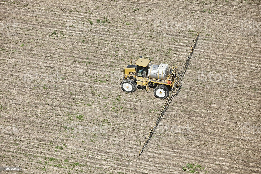 Sprayer Applying Herbicide to Corn Field royalty-free stock photo