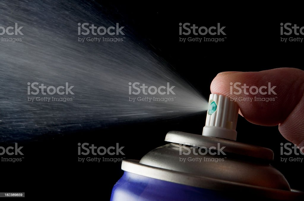 Spraying aerosol can isolated in black stock photo