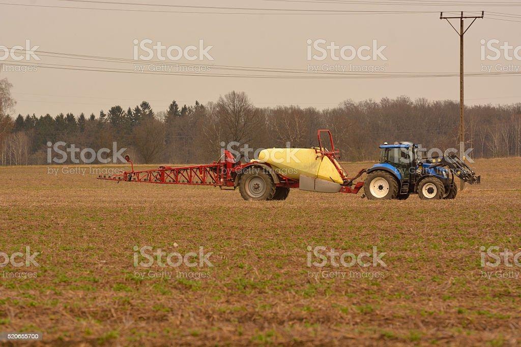 spraying fields stock photo