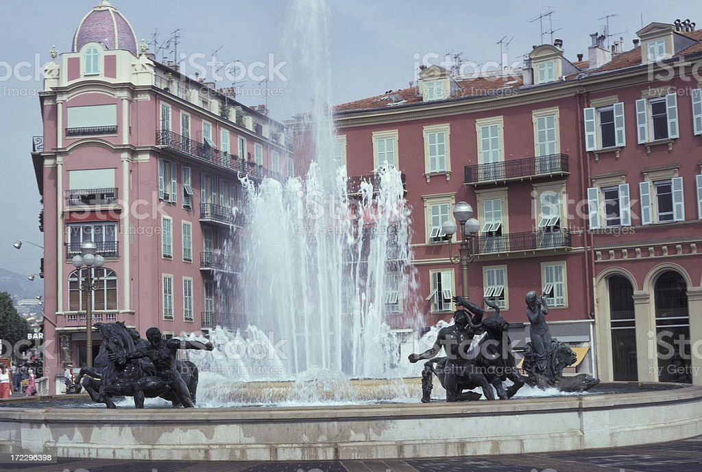 Spraying Fountain In Nice, France With Pink Hotel Background royalty-free stock photo