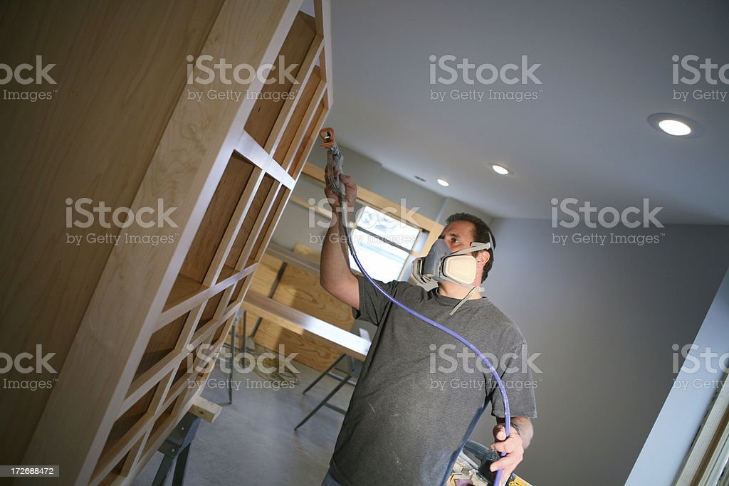 Spraying Lacquer on Custom Cabinets stock photo