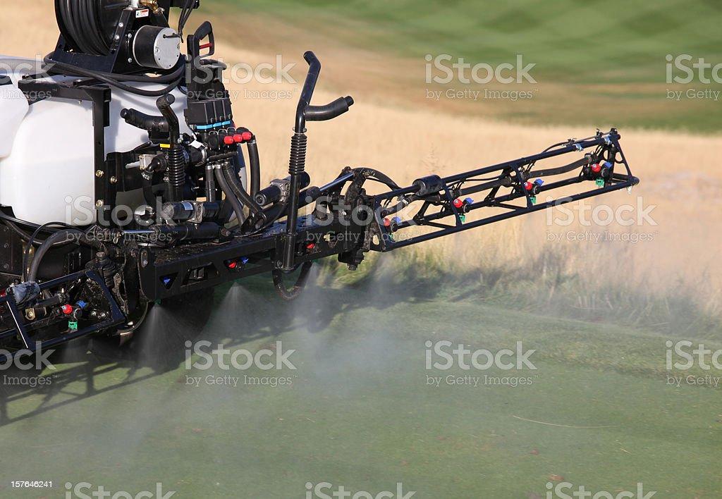 Spraying Liquid Fertilizer on a Golf Course royalty-free stock photo