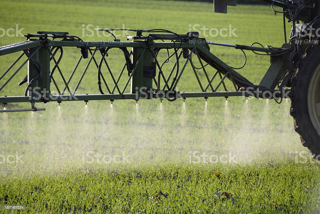 spraying on field royalty-free stock photo