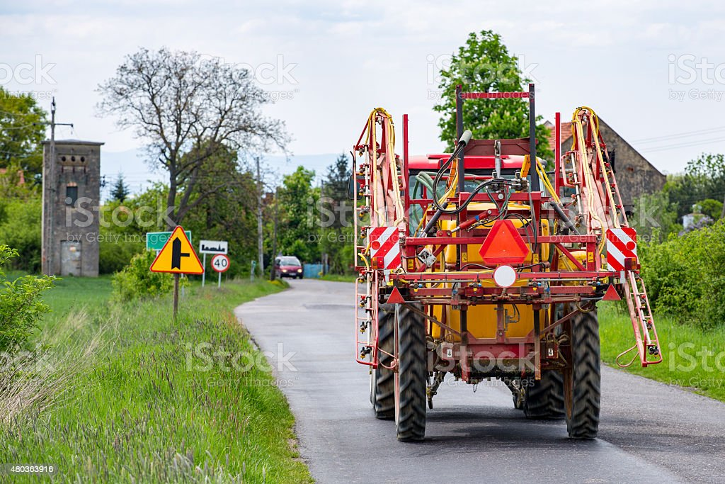 Spraying tractor stock photo