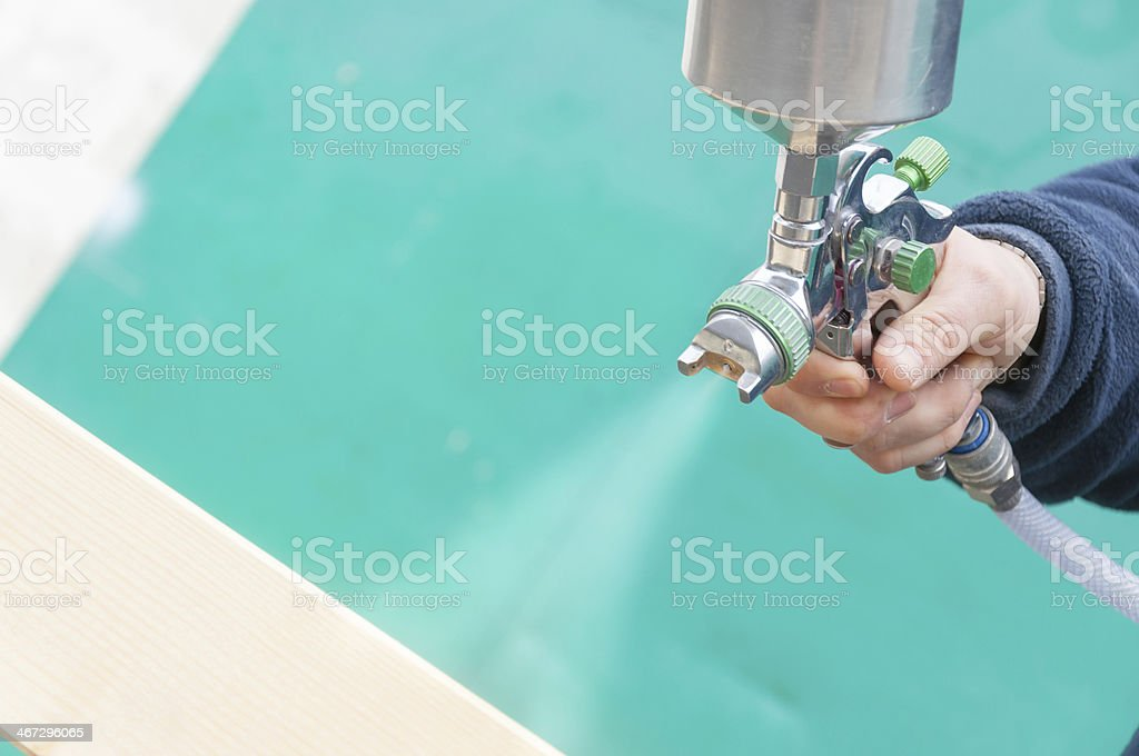 Spraying wood royalty-free stock photo