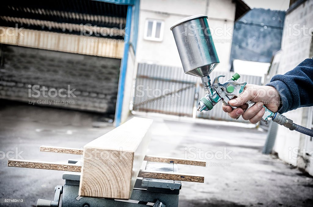 Spraying wood stock photo