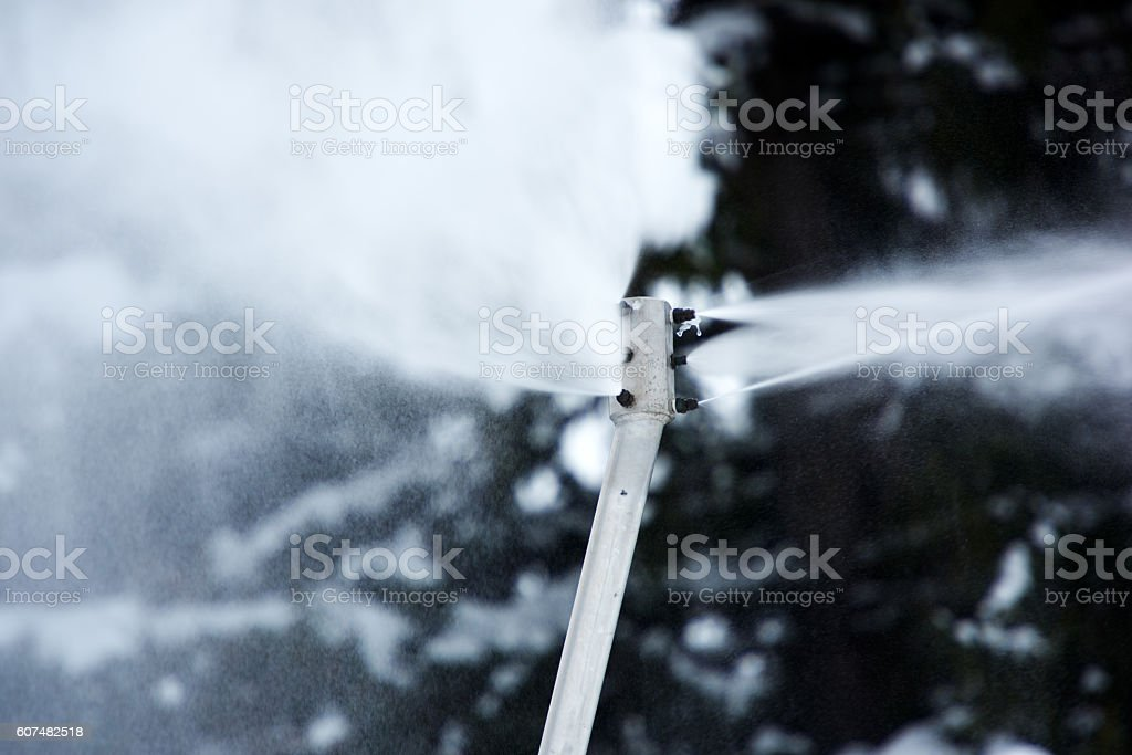 spreading artifical snow stock photo
