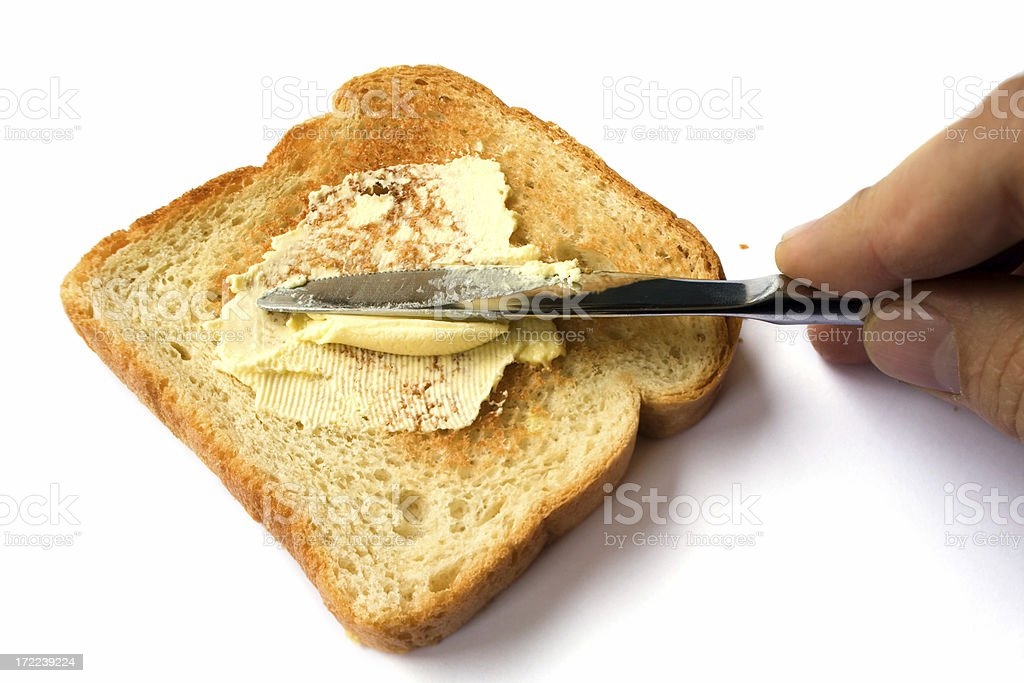 Spreading butter on toasted bread royalty-free stock photo