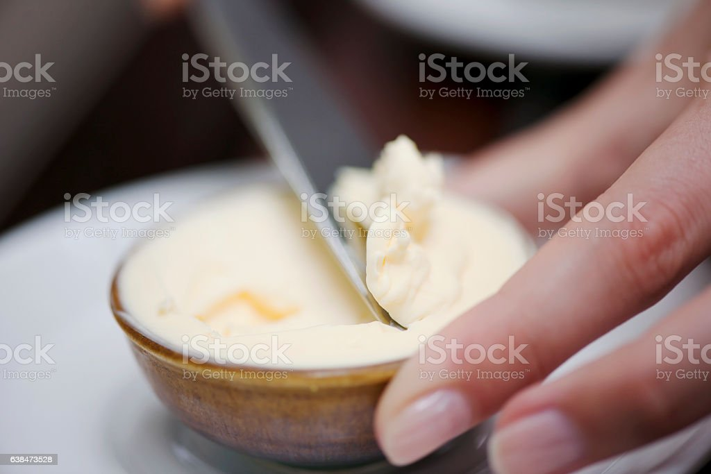 Spreading butter stock photo