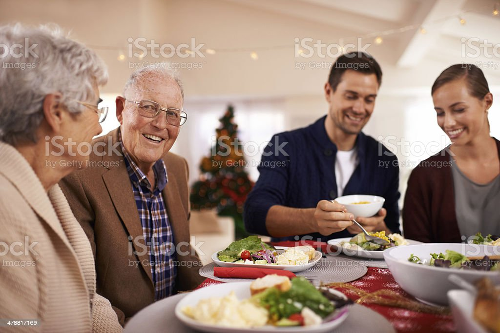 Spreading Christmas cheer with food and family royalty-free stock photo