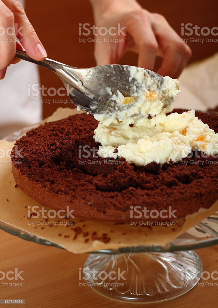 Spreading Cream and Stacking Layers royalty-free stock photo