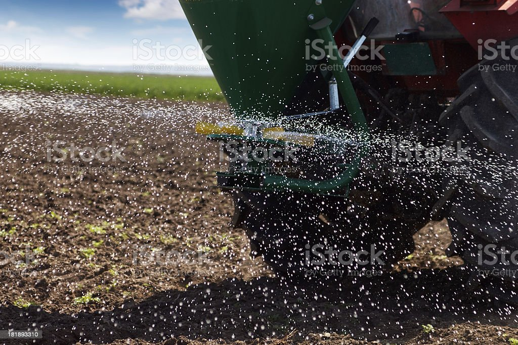 Spreading fertilizer royalty-free stock photo