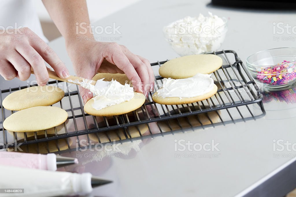 Spreading Frosting on a Cookie royalty-free stock photo
