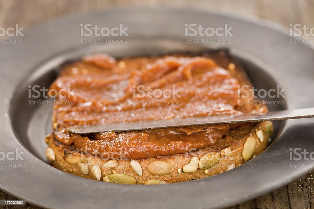 Spreading Fruit Butter On Toast royalty-free stock photo