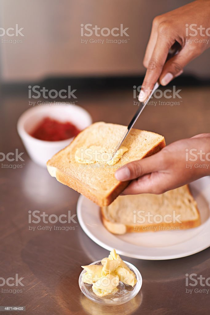 Spreading on some buttery goodness stock photo