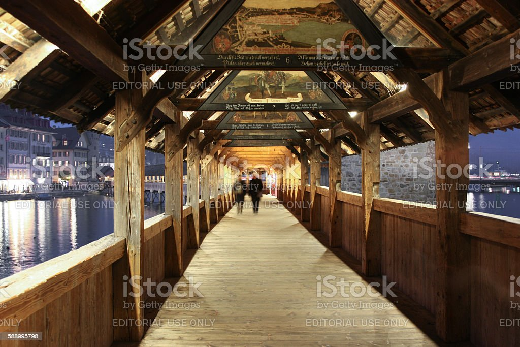 Spreuer Bridge is an old, covered wooden  with ancient paintings stock photo